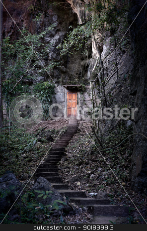 door into the dark mountain stock photo, cabin door built into side of a dark mountain by Phil Morley