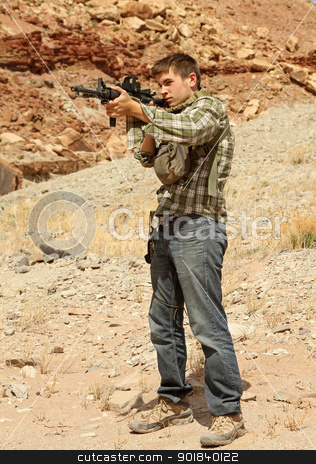 Young man target shooting. stock photo, Young man target shooting with rifle. by asbasb