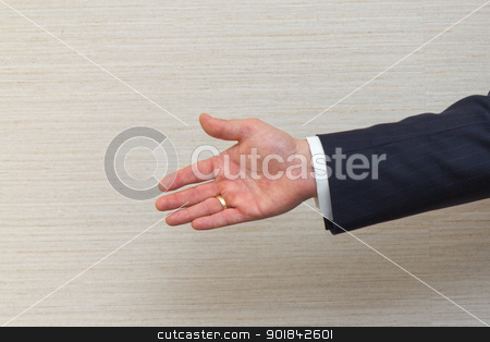 Business man offering a handshake stock photo, Business man offering a handshake. by Click Images