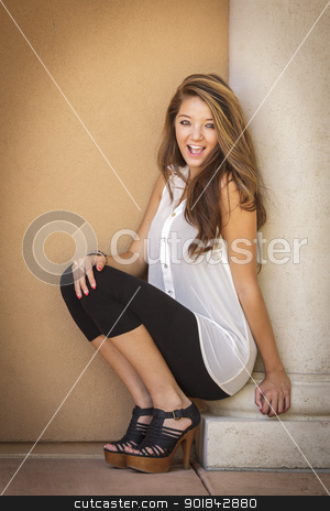 Attractive Mixed Race Girl Portrait stock photo, Attractive Mixed Race Girl Portrait Sitting Outdoors Against Wall. by Andy Dean