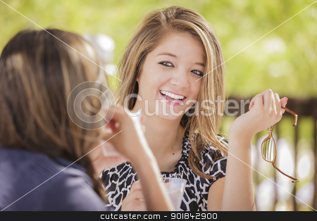 Attractive Mixed Race Girlfriends Talking Over Drinks Outside stock photo, Attractive Mixed Race Girlfriends Talking Over Drinks Outdoors. by Andy Dean