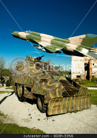 Military vehicle and MIG 21 airplane  stock photo, Military vehicle Armoured personnel carrier and Croatian air forces MIG 21 airplane in Turanj war museum, Croatia,  by xbrchx