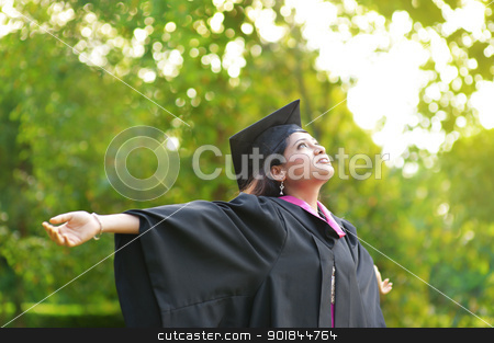 Graduation day stock photo, Young Asian Indian female student open arms outdoor on graduation day by szefei