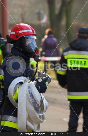 Fireman ready for action stock photo, Portrait of fireman in uniform with hose taken in Zgorzelec, Poland by Oxygen64