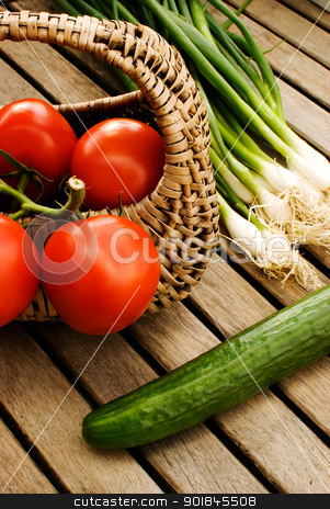 vegetables stock photo, fresh vegetables tomatoes cucumber and green onion in basket over wooden table by Desislava Dimitrova