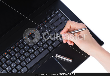 Hand with pen on laptop keyboard stock photo, Hand with fountain pen on laptop keyboard isolated on white background by nvelichko