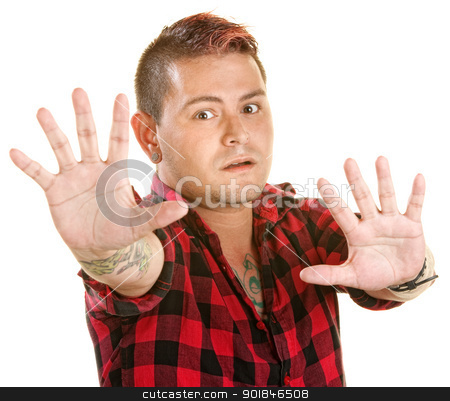 Tense Man Reaching Out stock photo, Tense man with spiky hair reaching out with hands by Scott Griessel