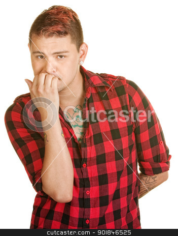 Man Biting Fingernails stock photo, Concerned male in flannel shirt biting fingernails by Scott Griessel