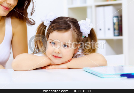 Little girl and study stock photo, Little girl sitting and studying at home by Sergey Nivens