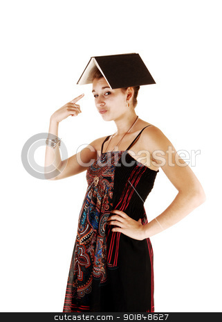 Portrait of girl with book on head. stock photo, A portrait picture of a student in a dress and an book on her head, for white background and pointing with her finger at the book.  by Horst Petzold