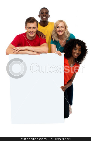 Group of teenagers displaying white banner stock photo, Group of teenagers displaying white banner in front of camera by Ishay Botbol
