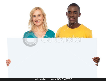 Attractive couple holding white blank ad board stock photo, Attractive couple holding white blank ad board looking at you by Ishay Botbol