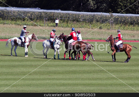 Polo match stock photo, Polo players on horses jostle for the ball with umpire looking on. by Abdul Sami Haqqani