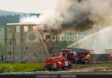 Fire extinguishing stock photo, Fire brigade behind work on fire extinguishing by Aikon