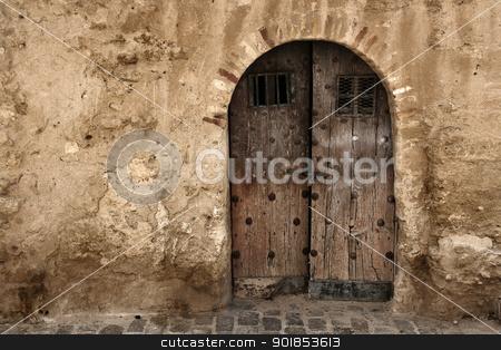 Puerta stock photo, puerta de arco en pared con mucha textura by Raquel Vidal Bielsa