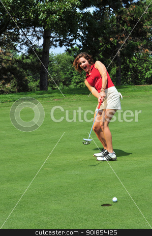 Body English stock photo, A pretty lady golfer urges a putt to go in using body english by Jim Fitzroy