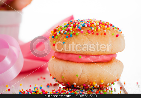 Strawberry cookies stock photo, Cookies with strawberry cream covered with sprinkles on white background by p.studio66