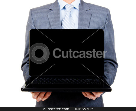 Business man holding blank laptop stock photo, Business man holding a blank laptop for copy space on isolated background by Stephen Laurence