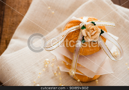 Vanilla cookies stock photo, Vanilla cookies as present on napkin and wooden table by p.studio66