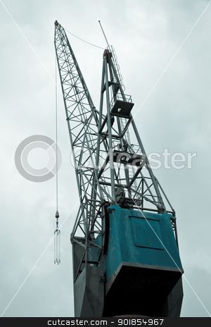 Big crane in port stock photo, Big crane on quay in port with cloudy sky background by Colette Planken-Kooij