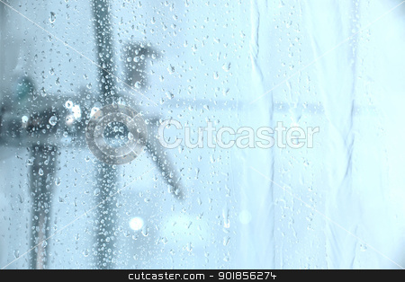 Under the Shower stock photo, Water dropping down the glass of a shower. by Michael Osterrieder