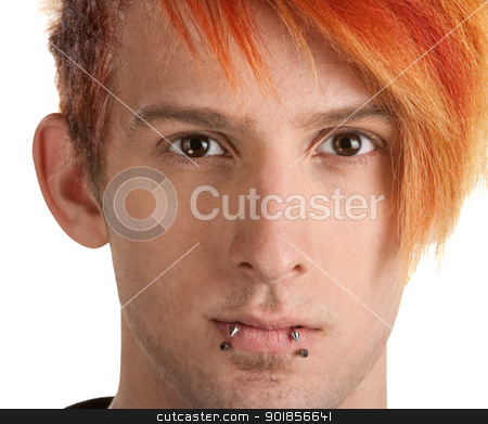 Serious Teen with Lip Piercing stock photo, Close up of male with orange hair over white by Scott Griessel