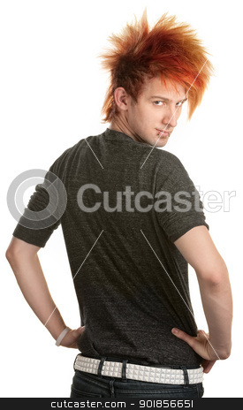 Teen Looking Over His Shoulder stock photo, Young man with orange mohawk looking over his shoulder by Scott Griessel