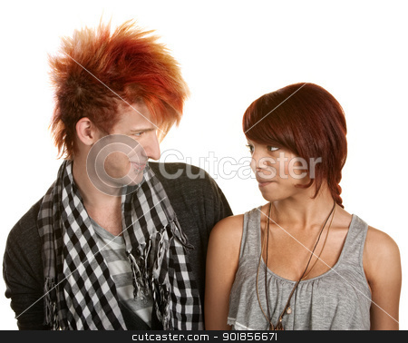 Couple Looking at Each Other stock photo, Smiling pierced teen couple looking at each other by Scott Griessel