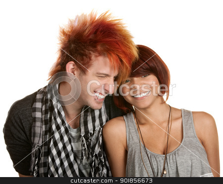 Giggling Teenage Couple stock photo, Giggling young teenage couple over white background by Scott Griessel