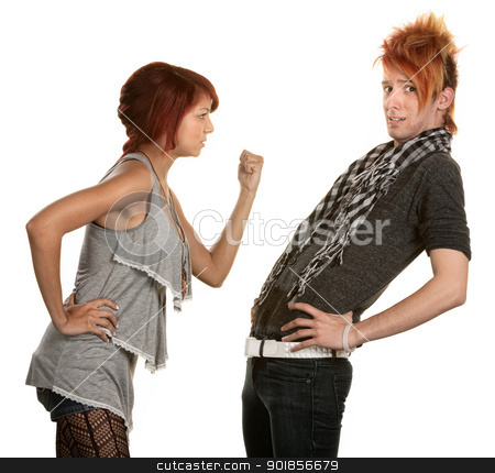 Woman Threatening Boyfriend stock photo, Woman shakes a clenched fist at boyfriend in orange hair by Scott Griessel