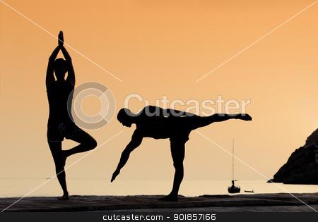 yoga exercise stock photo, healthy couple doing yoga exercises outdoors by mandygodbehear