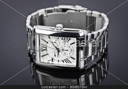 Men's wrist watch on black background. Studio shoot. stock photo,  by Paul Pirosca