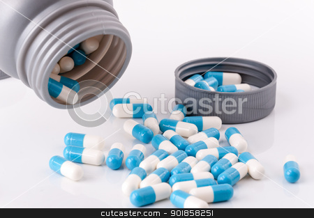 drug tablet stock photo, open container with medicament in tablet form by Aurelio Scetta