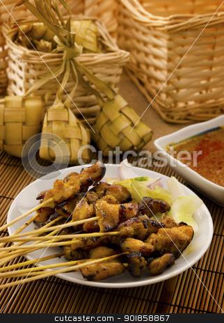 Asian Malay food stock photo, Asian Malay Ramadan food, satay chicken and ketupat in low light by szefei