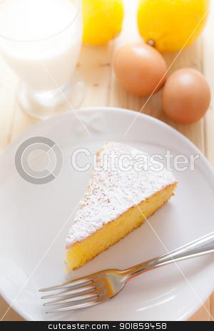 Lemon Cake stock photo, Slice of lemon cake in a dish on wood table by Giordano Aita