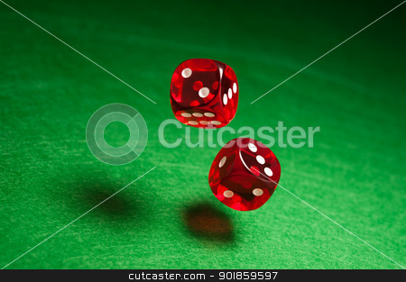 Rolling red dice  stock photo, Rolling red dice over green surface by Ulrich Schade