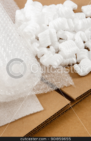 Corrugated Box And Packaging Materials stock photo, Protective packaging materials atop brown corrugate boxes show an assortment of shipping supplies by Karen Sarraga