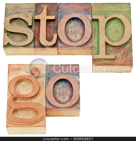 stop and go words in wood type stock photo, stop and go - isolated words in vintage letterpress wood type by Marek Uliasz