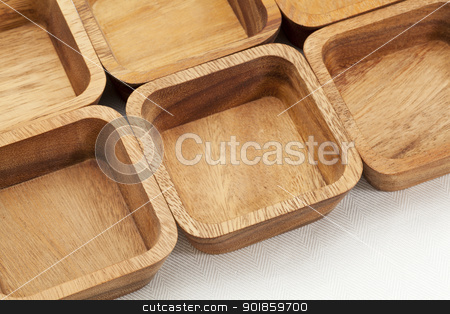 six square wooden bowls stock photo, background and pattern of six wooden bowls with different wood grain against tablecloth by Marek Uliasz