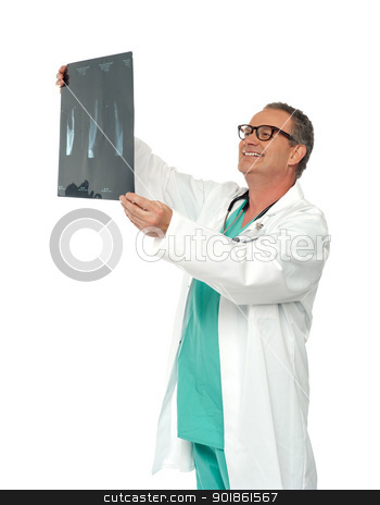 Experienced surgeon looking at x-ray report stock photo, Experienced surgeon looking at x-ray report isolated over white background by Ishay Botbol