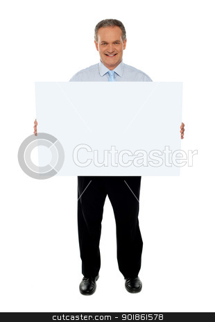 Confident businessman holding blank billboard stock photo, Full length portrait of confident businessman holding blank billboard isolated over white by Ishay Botbol