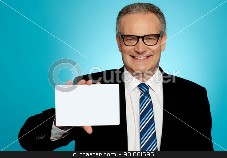 Businessman in glasses showing placard stock photo, Businessman wearing glasses showing blank white placard to camera by Ishay Botbol
