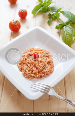 Risotto al pomodoro stock photo, Dish of tomatoes risotto on wood table by Giordano Aita