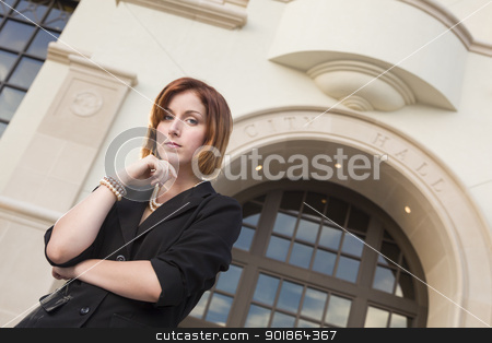 Young Pretty Businesswoman Outside in Front of City Hall stock photo, Proud Serious Young Pretty Businesswoman Portrait Outside in Front of City Hall Building. by Andy Dean