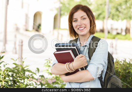 Smiling Young Female Student Outside with Books stock photo, Smiling Young Pretty Female Student Standing Outside with Books and Backpack. by Andy Dean