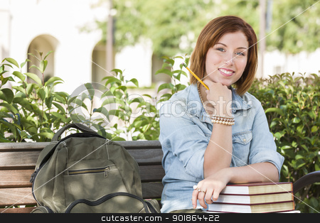 Young Female Student On Campus with Backpack on Bench stock photo, Smiling Young Pretty Female Student Outside on Campus with Backpack and Books Sitting on Bench. by Andy Dean