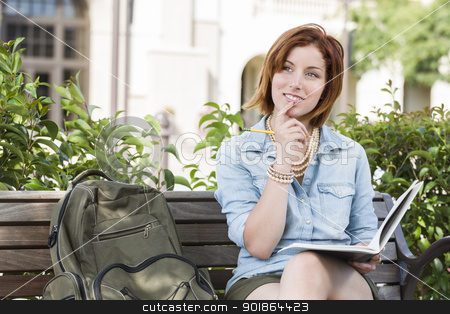 Young Female Student On Campus with Backpack on Bench stock photo, Smiling Young Pretty Female Student Outside on Campus with Backpack and Book Sitting on Bench. by Andy Dean