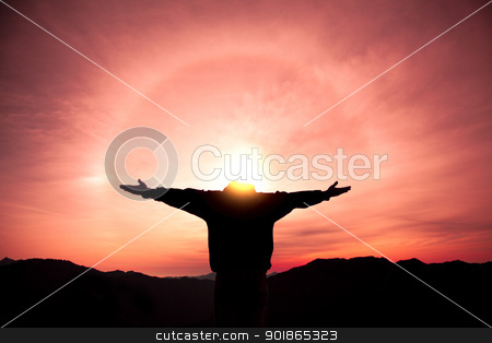 man standing on the top of mountain and watching the sunrise stock photo, man standing on the top of mountain and watching the sunrise by tomwang