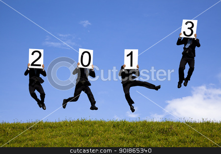 businessman holding 2013  and jumping on the green field stock photo, businessman holding 2013  and jumping on the green field by tomwang