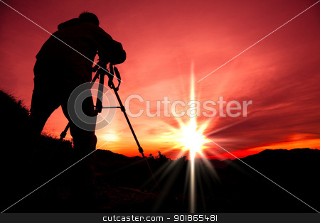 Silhouette of photographer on the top of mountain stock photo, Silhouette of photographer on the top of mountain by tomwang